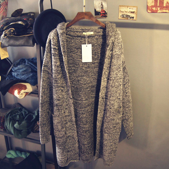 In the long section of gray hooded sweater coat